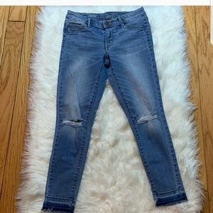 denim mid rise skinny jeans with holes in knees